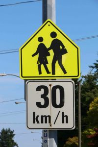 School Zone sign (Advisory) with regulatory sign attached for posted 30 km/h speed limit (photo by WestCoastDriverTraining.com)