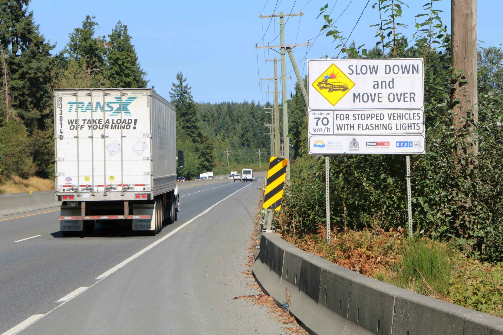 Sign on the Trans-Canada Highway on Vancouver Island stating the British Columbia laws for driving around emergency vehicles on B.C. highways. (photo by West Coast Driver Training & Education)