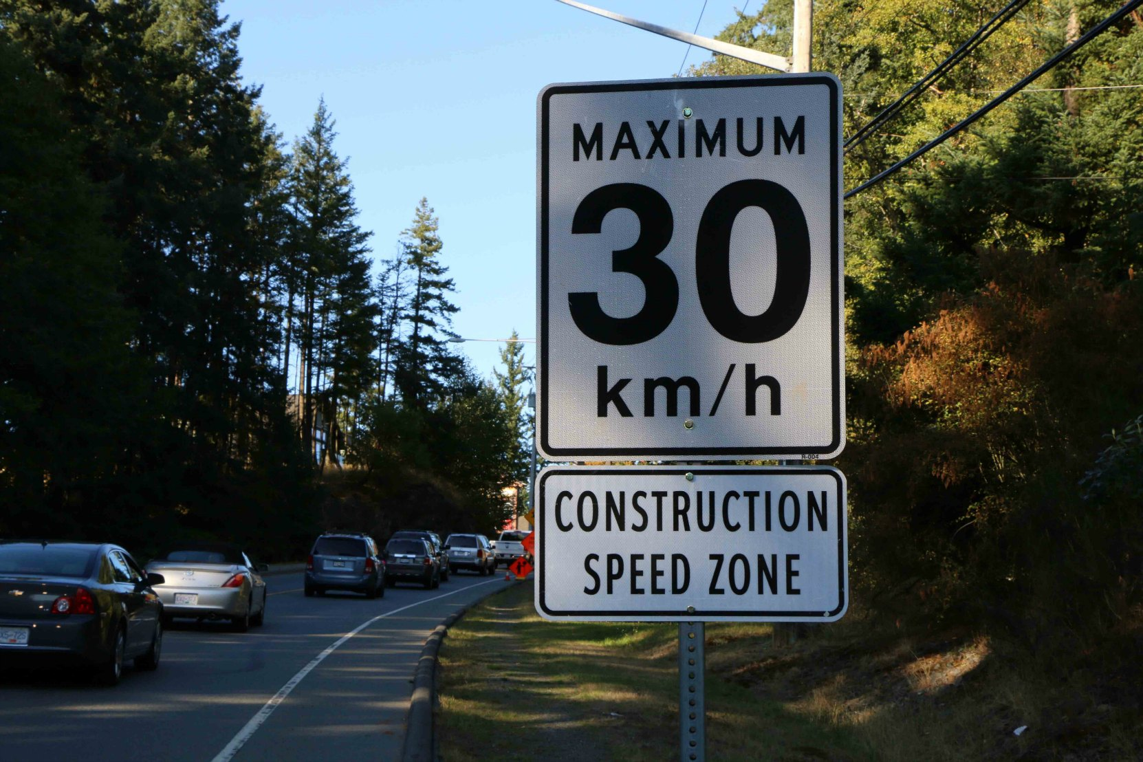 Highway construction zones in British Columbia typically display temporary Regulatory signs showing posted speed limit in the construction zone. (photo by WestCoastDriver Training.com)
