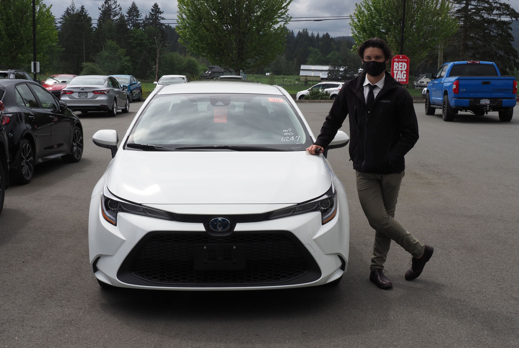 Product Adviser Axel Clarke with our new 2021 Toyota Corolla Hybrid that has arrived at Jim Pattison Toyota in Duncan (photo: West Coast Driver Training)